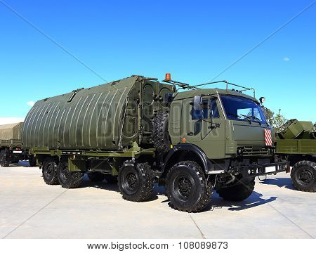 MOSCOW REGION  -   JUNE 17: Military all terrain truck with with an item for a pontoon bridge -  on June 17, 2015 in Moscow region