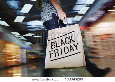 Walking shopper with Black Friday paperbag