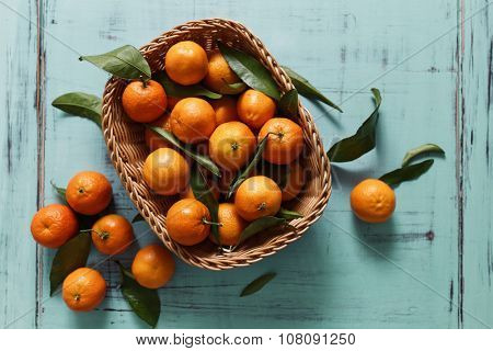 Basket of Tangerines on a wooden table