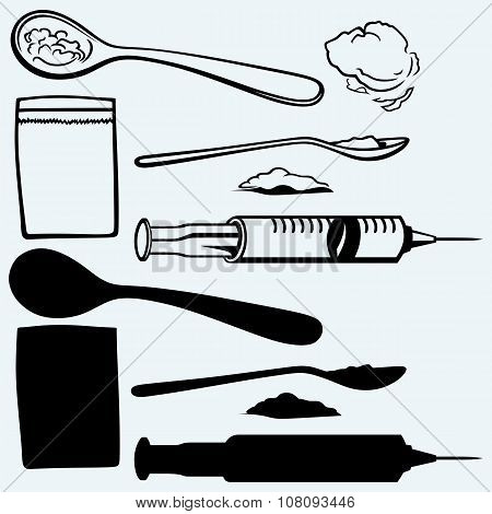 Drug syringe. Cooked heroin on spoon