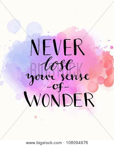 Never lose your sense of wonder. Black inspirational quote on purple watercolor imitation background