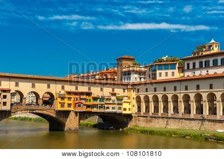 poster of Bridge Ponte Vecchio across River Arno in the sunny summer day, Florence, Tuscany, Italy