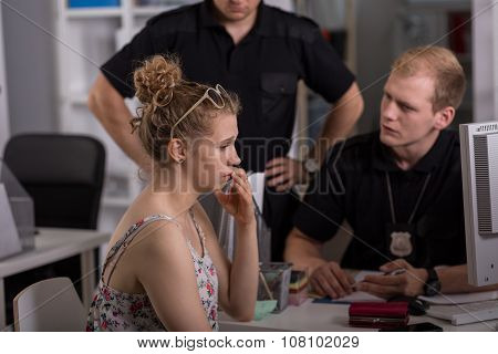 Policeman Questioning Woman