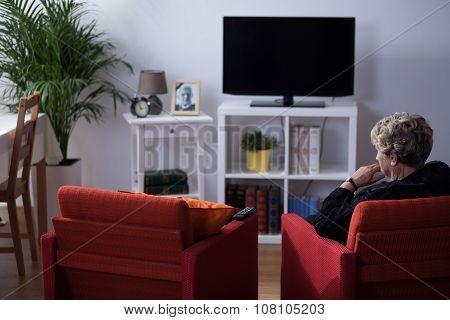 Widow Sitting In Living Room