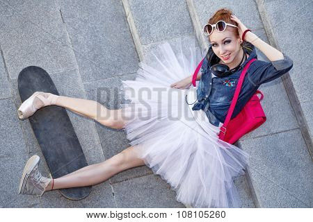 Ballerina Hipster Sitting On The Stairs.