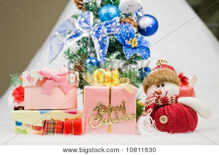 Christmas Greeting Santa With Gifts Front Of A Christmas Tree