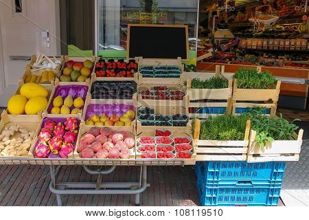 Shelf With Fresh Fruits And Herbs In Greengrocery Store In Zandvoort, The Netherlands