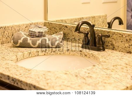 Sink With Granite Vanity And Bronze Fixtures