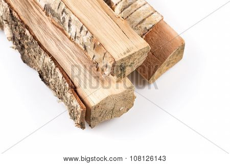 Stack of cut logs firewood from silver birch tree isolated on white background poster