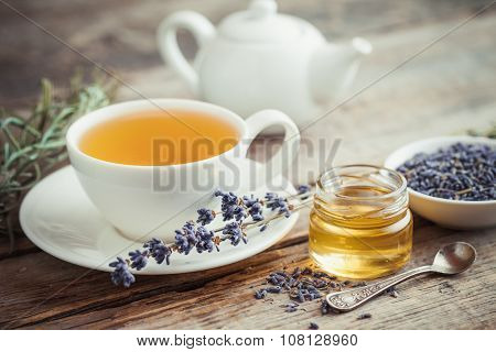 Healthy Tea Cup, Jar Of Honey, Dry Lavender Flowers And Teapot On Background.