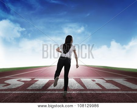 Back View Of Business Woman Running From Start Line