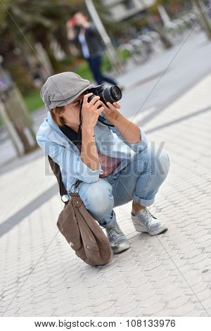 Woman reporter on a shooting day in urban area