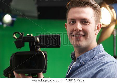 Male Camera Operator In Television Studio