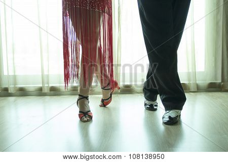 Closeup Of Legs Of Two Professional Latin Dancers