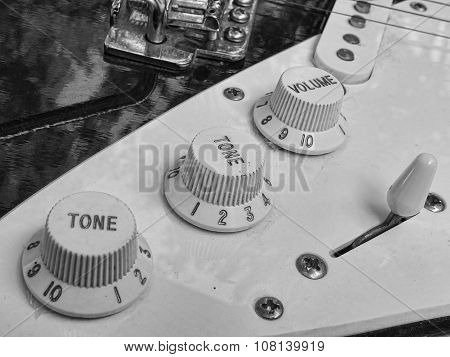 Close up shot of electric guitar knobs in black and white