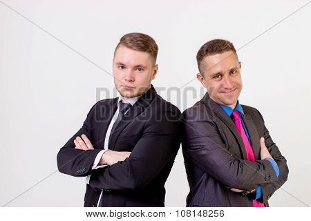 Two Business Men Standing Back To Back, Isolated