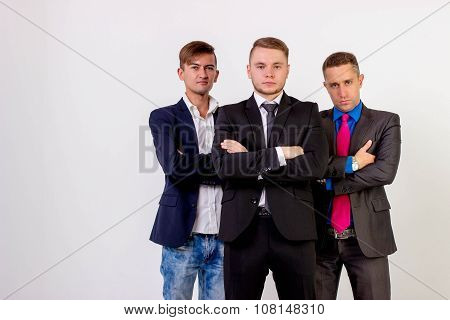 Three Business Men Standing Like A Team, Isolated On White Background