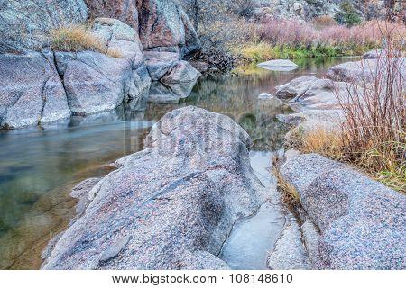 mountain stream in northern Colorado - North Fork of Cache la Poudre River at Eagle Nest Open Space near Livermore,late fall scenery