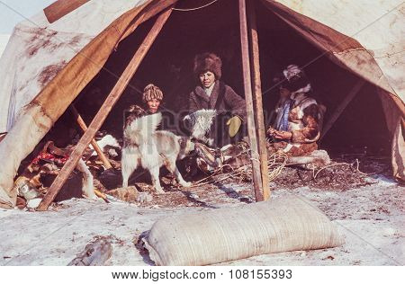 Caucasian woman having conversation with family of the indigenous people inside of their yaranga