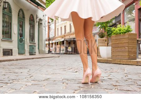 Woman with beautiful legs wearing high heel shoes