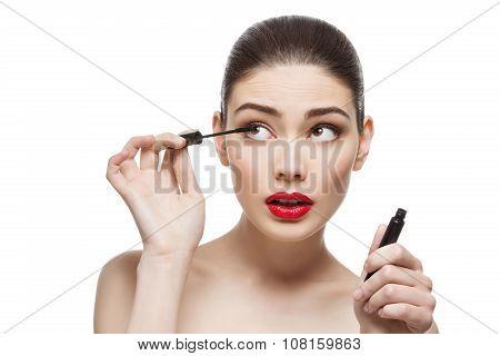 Beautiful girl with mascara tube