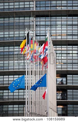 STRASBOURG FRANCE - 14 Nov 2015: European Union Flags and France flag flies at half-mast in front of the European Parliament building following an terrorist attack in Paris ** Note: Visible grain at 100%, best at smaller sizes