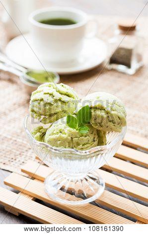 Green Tea Ice Cream On White Wood Board