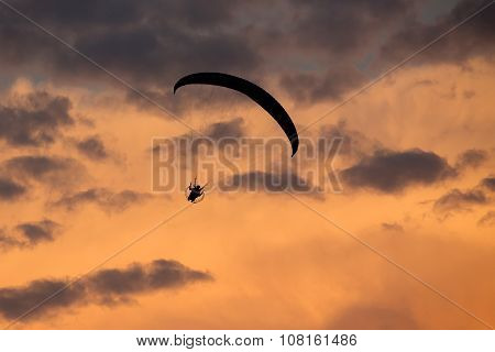 Unidentified Skydiver, Parachutist On Dramatic Sky