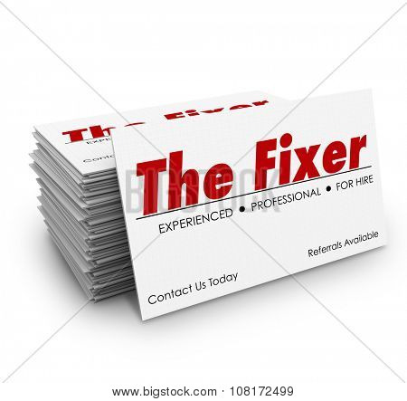 The Fixer words on a business card in stack or pile for a professional who can solve a problem or make trouble go away