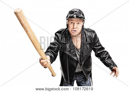 Angry and violent senior biker swinging with a baseball bat isolated on white background