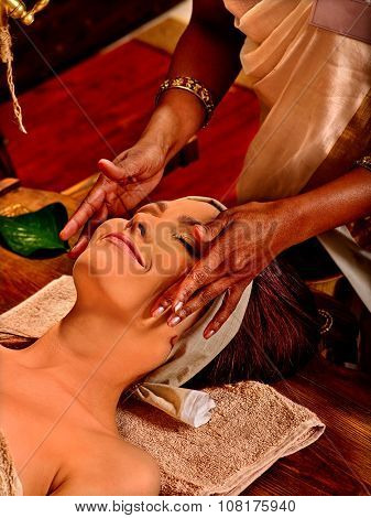 Woman having facial  ayurveda spa treatment and massage.