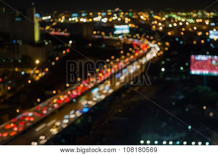 Abstract blurred bokeh lights at night, city highway during busy hour