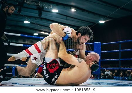 ground fighting is of two athletes of mixed martial arts