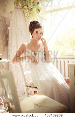 Beautiful bride in white dress on her wedding day