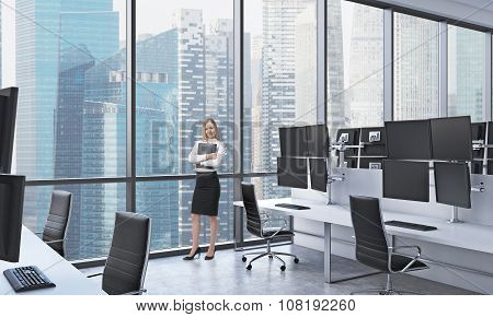 A Young Lady In Formal Clothes Holds A Black Document Folder In The Modern Panoramic Office In Singa