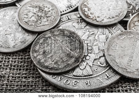 silver coins on a sacking