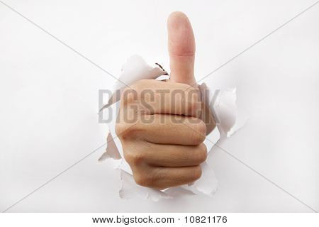 hand break through the white paper with Thumb up