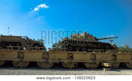 M60 Patton Tank With M9 Dozer Blade And M3 Half-track Carrier On Pontoon Bridge. Latrun, Israel