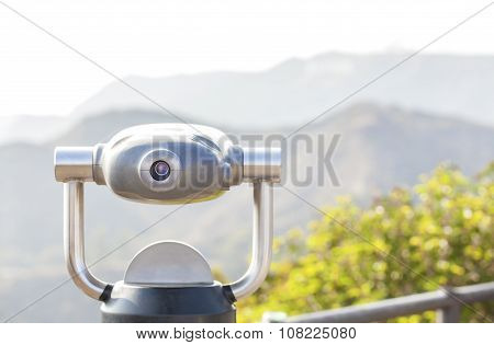 Monocular Pointed At Mountain Landscape, Shallow Depth Of Field