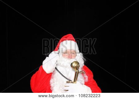Santa Claus takes orders for Christmas Presents on his Golden Telephone. Santa Phone. Call Santa. Santa Claus hot line. Hello this is Santa. Santa Claus talks on his Phone to people around the world.