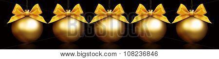 Golden Balls Hanging On Black Background