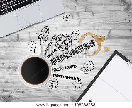 Top View Of A Cup Of Coffee And Black Business Icons Which Symbolises A Success In Business. A Lapto