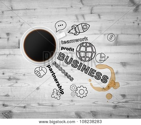 Top View Of A Cup Of Coffee And Black Business Icons Which Symbolises A Success In Business. Wooden