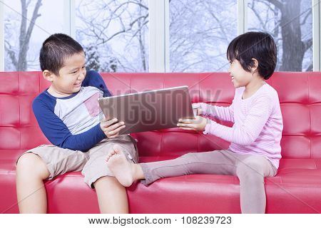 Two Kids Fighting To Take Over Laptop