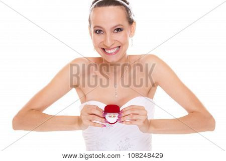 Excited happy bride holding showing engagement ring box. Surprised woman in white wedding dress isolated on white background. poster