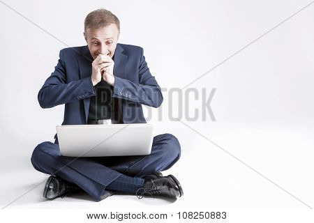 Business Concepts And Ideas. Portrait Of Exclaiming And Surprised Caucasian Business Man With Laptop
