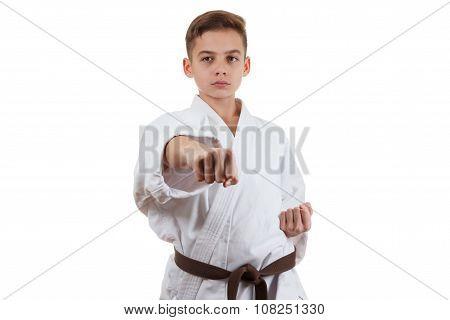 Martial art sport karate - child teen boy in white kimono training punch and block