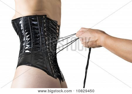 Male Hands Lacing Back Of A Corset