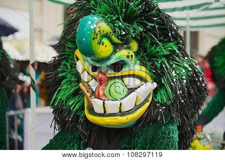 Person wears Waggis mask at Basel Carnival in Basel, Switzerland.