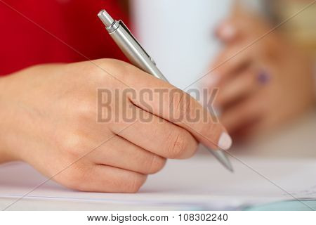 Female Hands Holding Cup Of Coffee Or Tea And Silver Pen Closeup